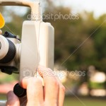 depositphotos_18002643-Surveyor-engineer-with-partner-making-measure-on-the-field